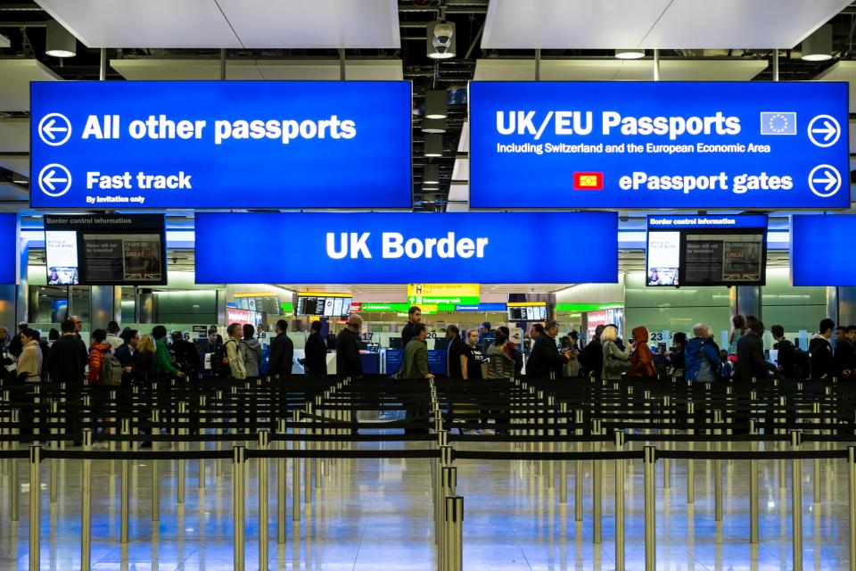 "Passport control lanes at airport: ""UK/EU"" and ""All other passports"""