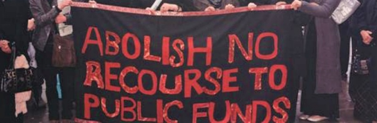 "Banner reads ""ABOLISH NO RECOURSE TO PUBLIC FUNDS"""