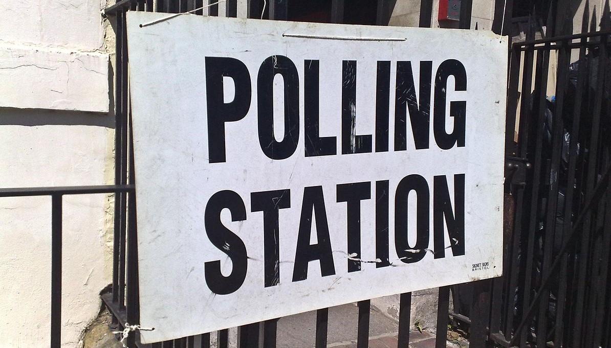 """polling station"" sign"